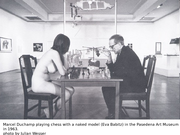 Marcel Duchamp playing chess with a naked model (Eva Babitz) in the Pasedena Art Museum