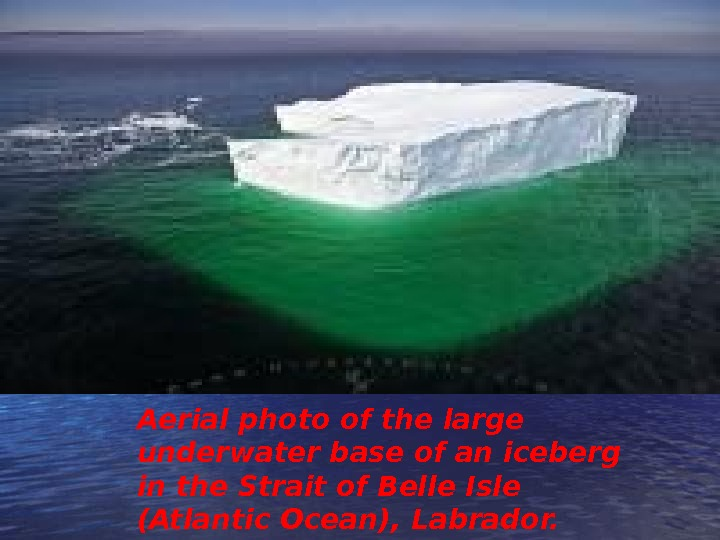 Aerial photo of the large underwater base of an iceberg in the Strait of Belle Isle