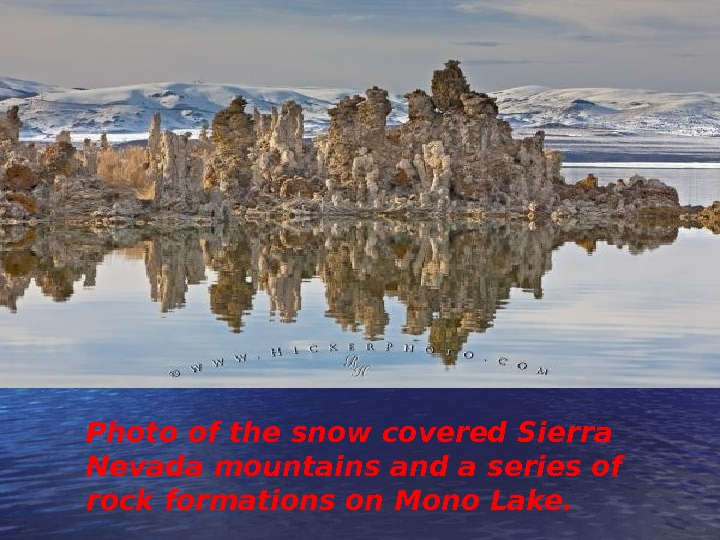 Photo of the snow covered Sierra Nevada mountains and a series of rock formations on Mono