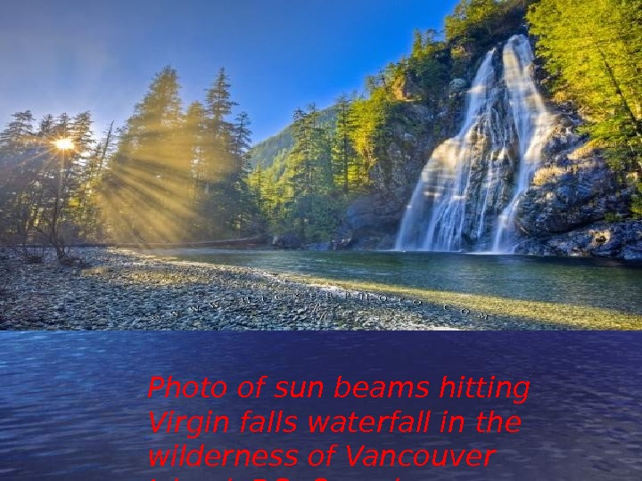 Photo of sun beams hitting Virgin falls waterfall in the wilderness of Vancouver Island, BC, Canada.