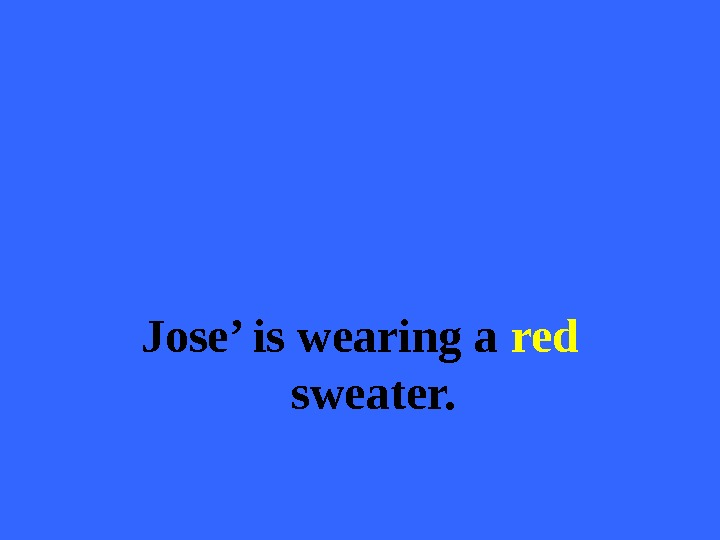 Jose' is wearing a red  sweater.