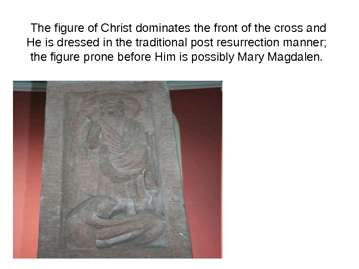 The figure of Christ dominates the front of the cross and He is dressed in