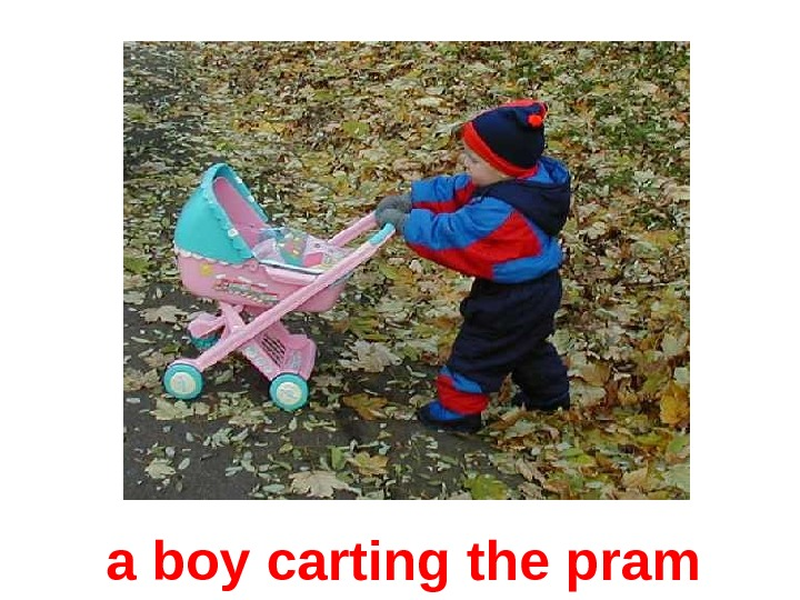 a boy  carting  the pram