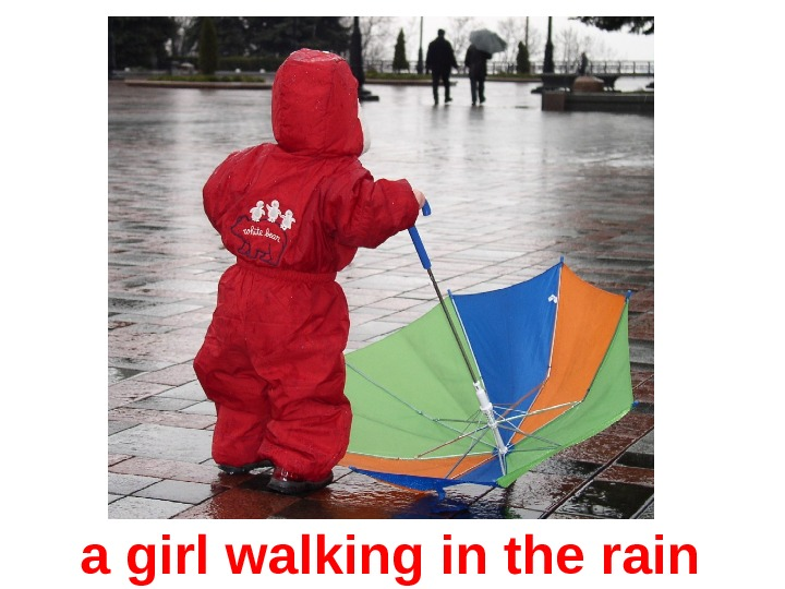 a girl walking in the rain