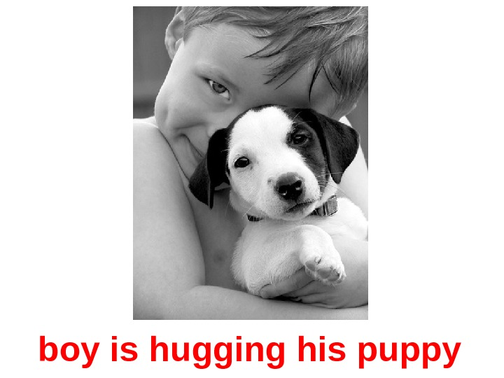 boy is hugging his puppy