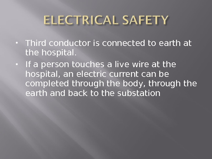Third conductor is connected to earth at the hospital.  If a person touches a