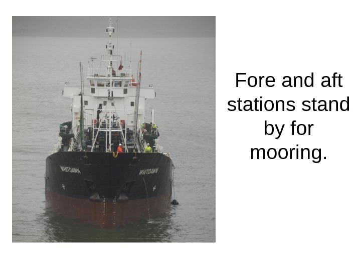 Fore and aft stations stand by for mooring.