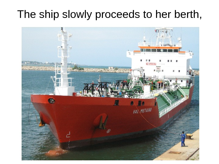 The ship slowly proceeds to her berth,