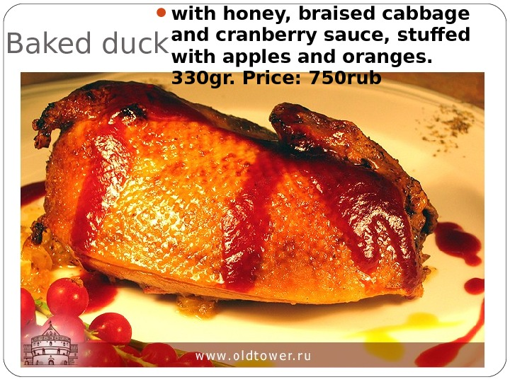 Baked duck  with honey, braised cabbage and cranberry sauce, stuffed with apples and oranges.