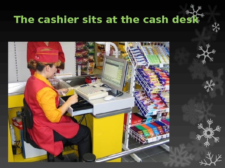 The cashier sits at the cash desk