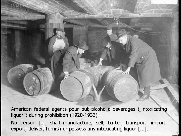 "American federal agents pour out alcoholic beverages (""intoxicating liquor"") during prohibition (1920 -1933). No"