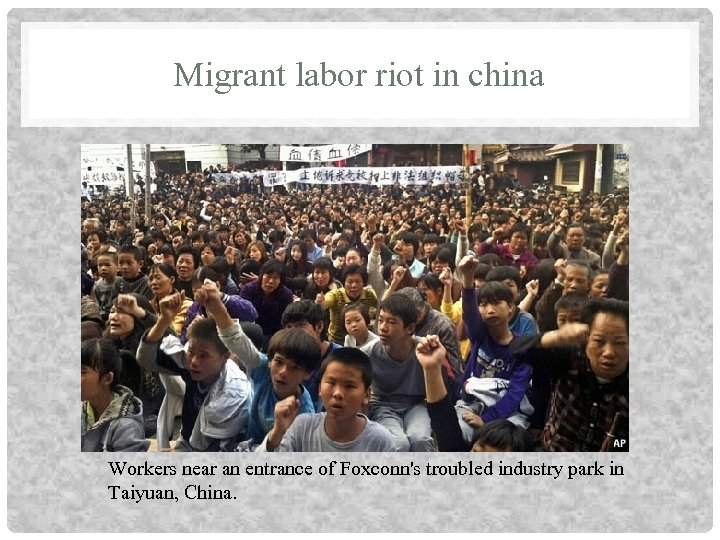 Migrant labor riot in china Workers near an entrance of Foxconn's troubled industry park