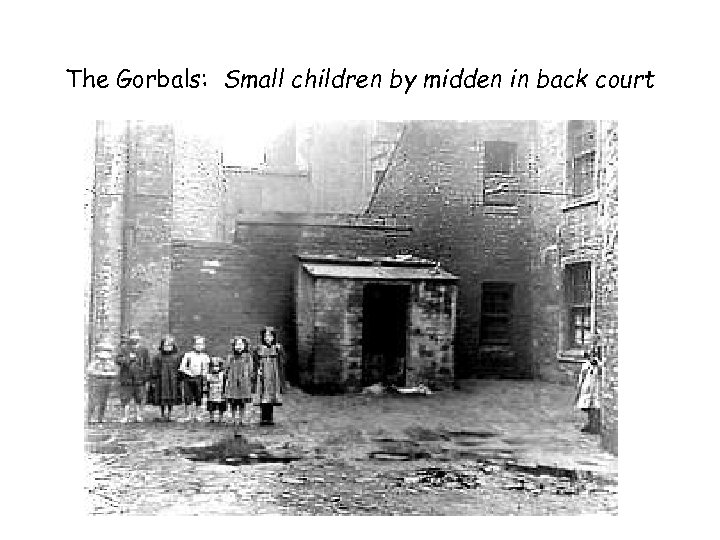 The Gorbals: Small children by midden in back court