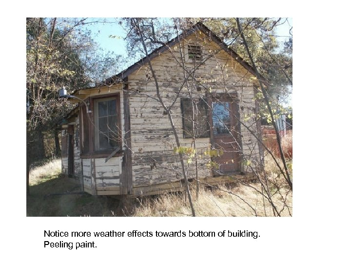 Notice more weather effects towards bottom of building. Peeling paint.
