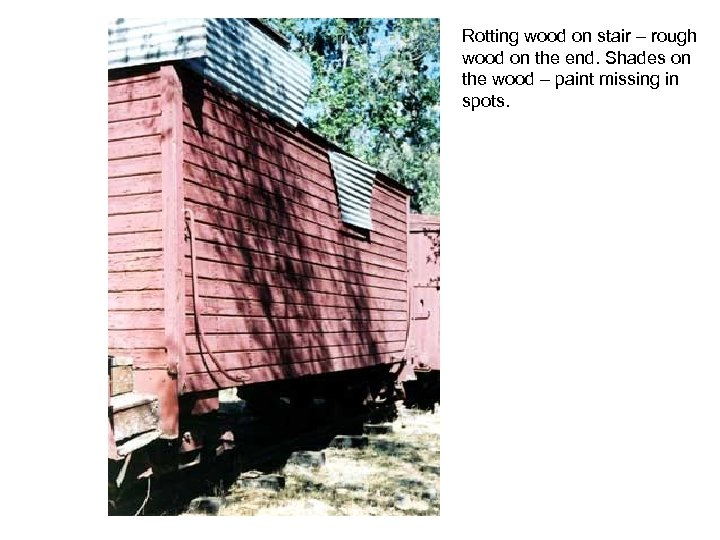Rotting wood on stair – rough wood on the end. Shades on the wood