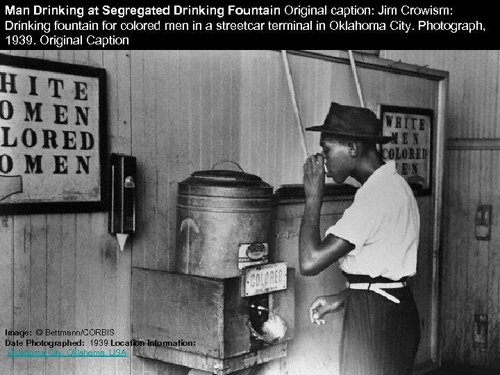 Man Drinking at Segregated Drinking Fountain Original caption: Jim Crowism: Drinking fountain for colored
