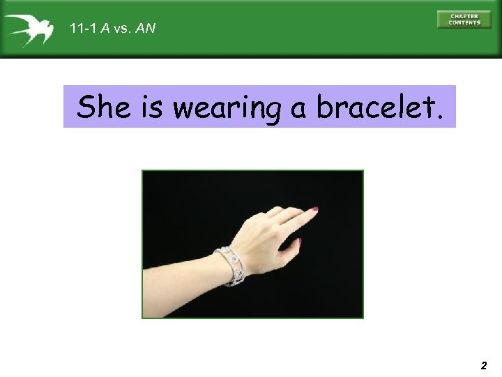 11 -1 A vs. AN She is wearing a bracelet. 2