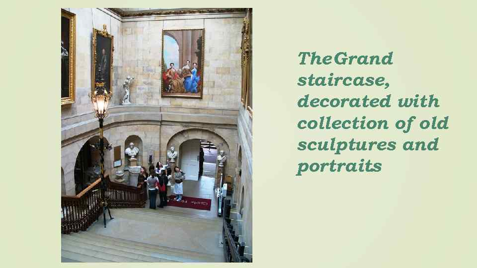 The Grand staircase, decorated with collection of old sculptures and portraits.