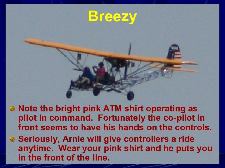 Breezy Note the bright pink ATM shirt operating as pilot in command. Fortunately the