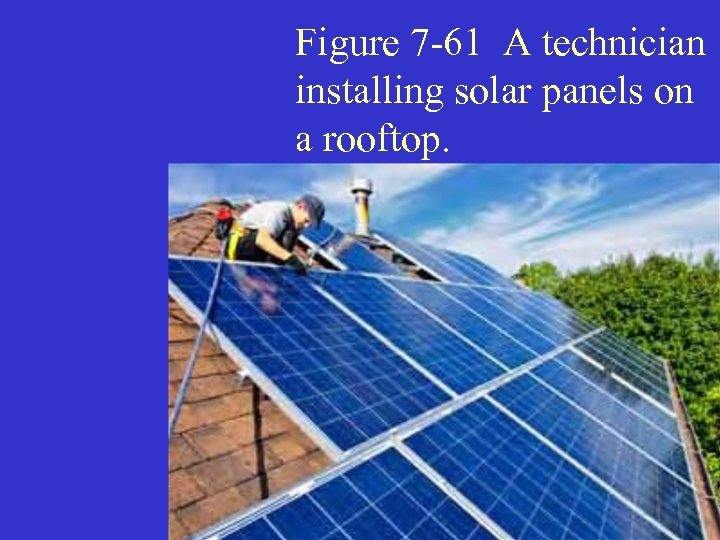 Figure 7 -61 A technician installing solar panels on a rooftop.