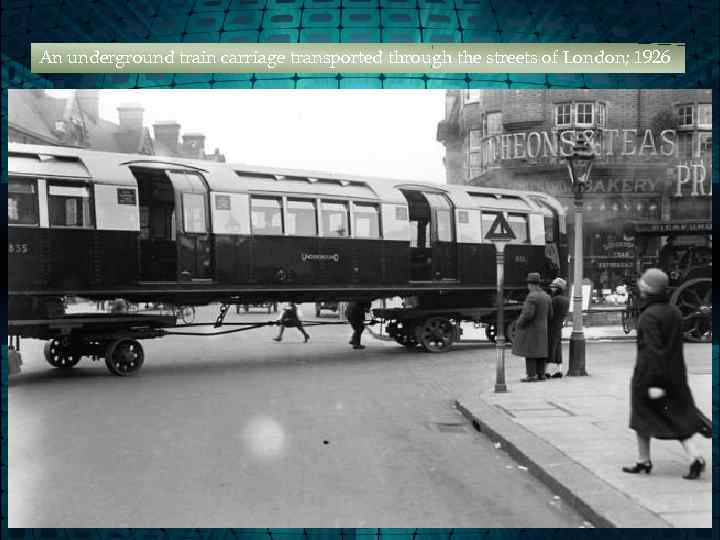 An underground train carriage transported through the streets of London; 1926