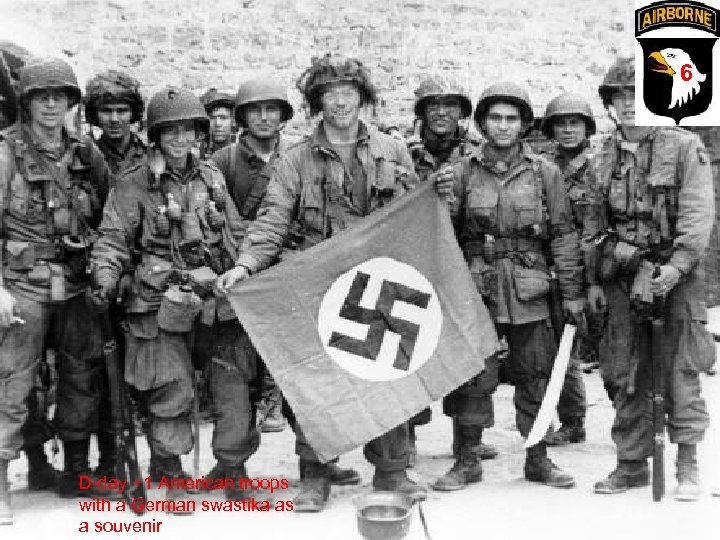 6 D-day +1 American troops with a German swastika as a souvenir