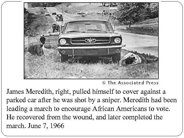 James Meredith, right, pulled himself to cover against a parked car after he was