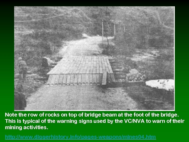 Note the row of rocks on top of bridge beam at the foot of