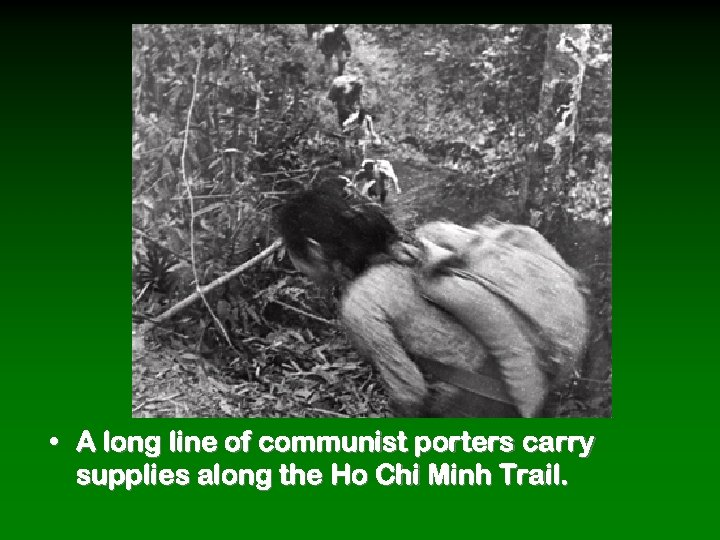 • A long line of communist porters carry supplies along the Ho Chi