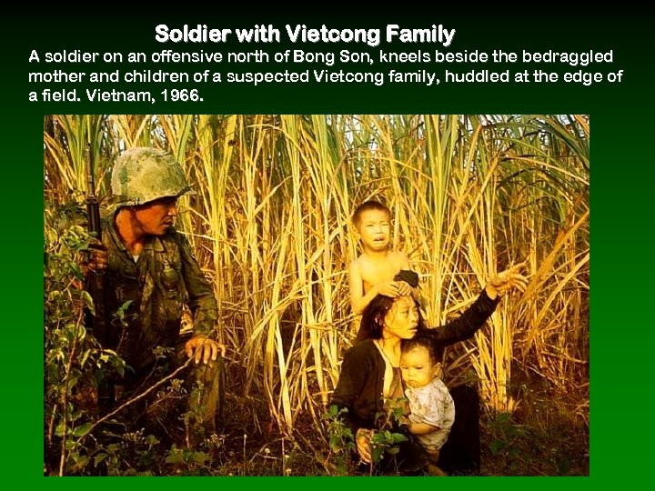 Soldier with Vietcong Family A soldier on an offensive north of Bong Son, kneels