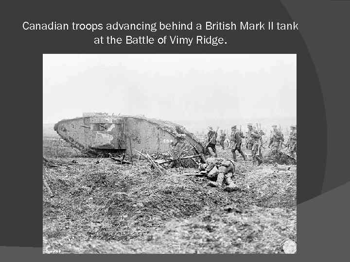 Canadian troops advancing behind a British Mark II tank at the Battle of Vimy