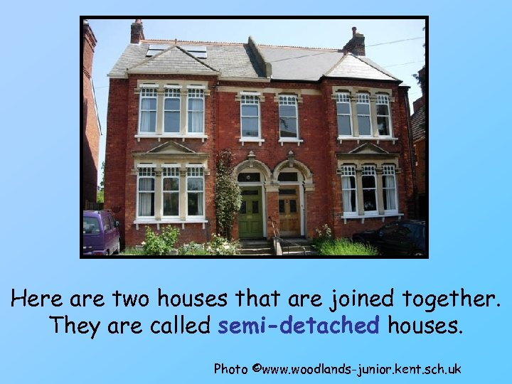 Here are two houses that are joined together. They are called semi-detached houses. Photo