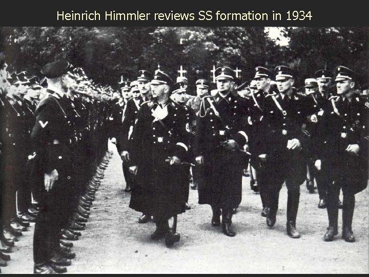 Heinrich Himmler reviews SS formation in 1934