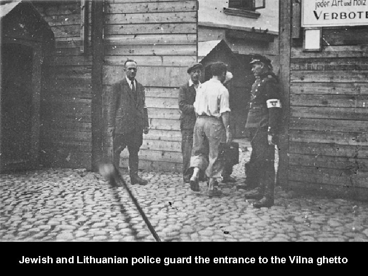 Jewish and Lithuanian police guard the entrance to the Vilna ghetto.