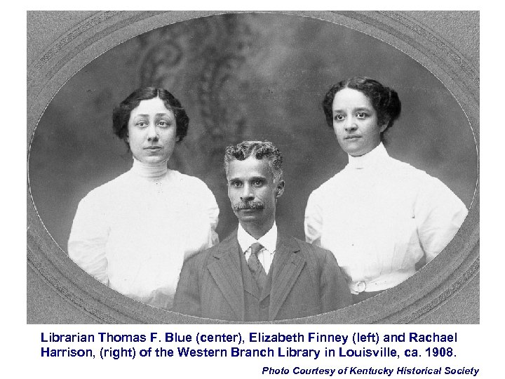 Librarian Thomas F. Blue (center), Elizabeth Finney (left) and Rachael Harrison, (right) of the