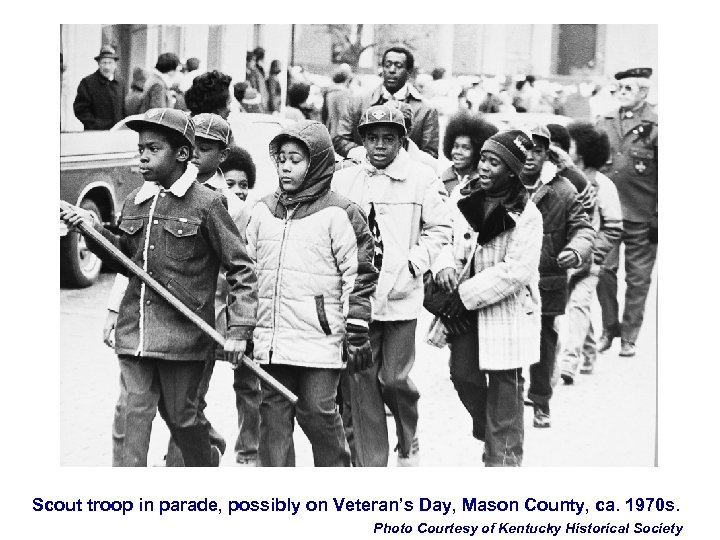 Scout troop in parade, possibly on Veteran's Day, Mason County, ca. 1970 s. Photo