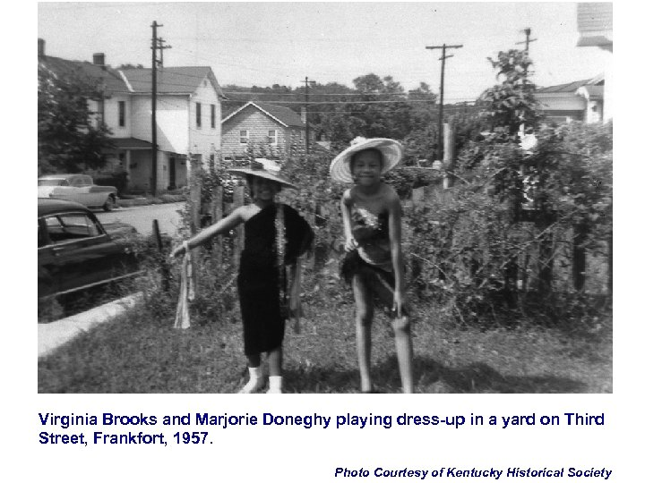 Virginia Brooks and Marjorie Doneghy playing dress-up in a yard on Third Street, Frankfort,