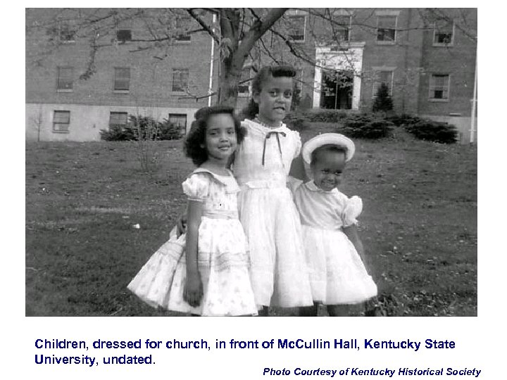 Children, dressed for church, in front of Mc. Cullin Hall, Kentucky State University, undated.