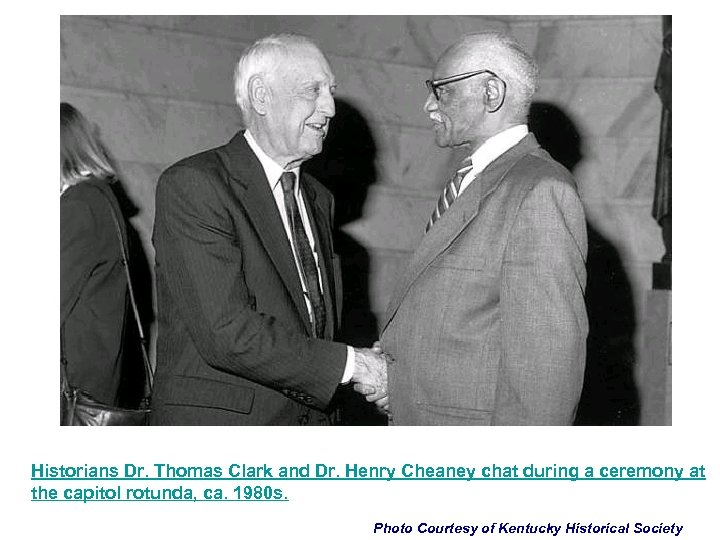 Historians Dr. Thomas Clark and Dr. Henry Cheaney chat during a ceremony at the