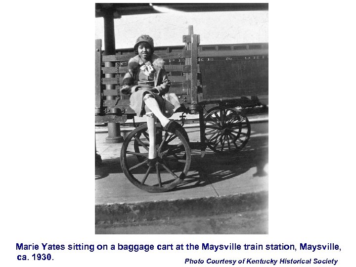 Marie Yates sitting on a baggage cart at the Maysville train station, Maysville, ca.