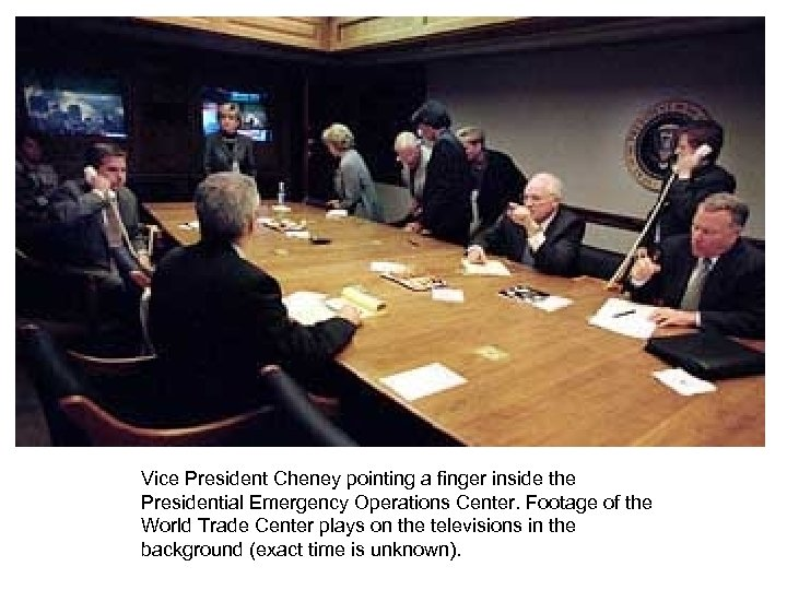 Vice President Cheney pointing a finger inside the Presidential Emergency Operations Center. Footage of