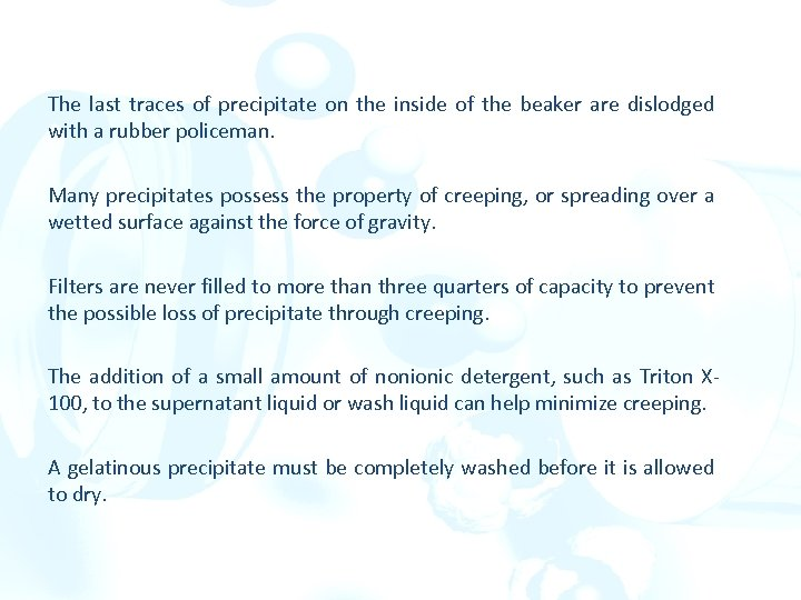 The last traces of precipitate on the inside of the beaker are dislodged with