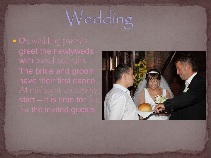 On wedding parents greet the newlyweds with bread and salts. The bride and