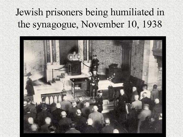 Jewish prisoners being humiliated in the synagogue, November 10, 1938