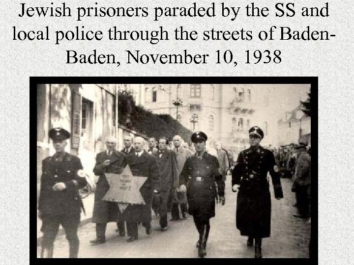 Jewish prisoners paraded by the SS and local police through the streets of Baden,