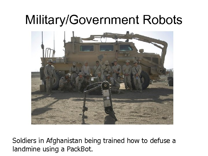 Military/Government Robots Soldiers in Afghanistan being trained how to defuse a landmine using a