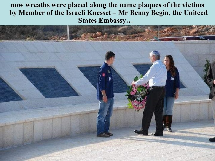 now wreaths were placed along the name plaques of the victims by Member of