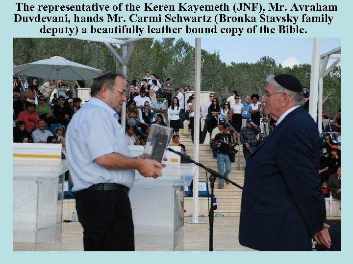The representative of the Keren Kayemeth (JNF), Mr. Avraham Duvdevani, hands Mr. Carmi Schwartz
