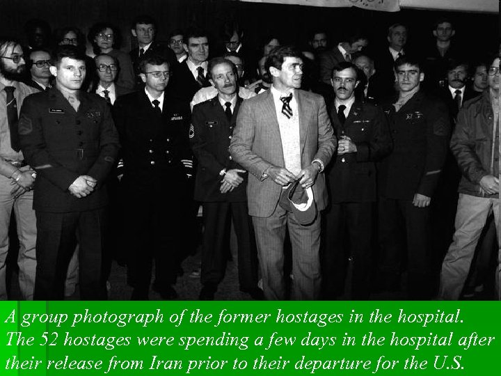A group photograph of the former hostages in the hospital. The 52 hostages were