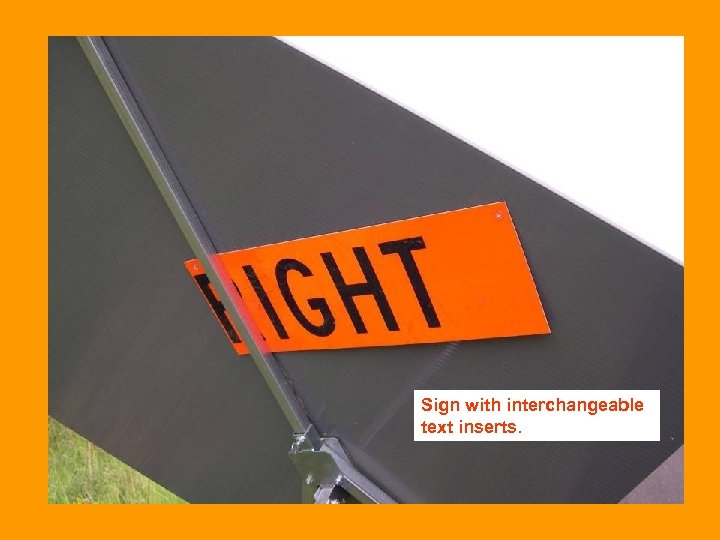 Sign with interchangeable text inserts.